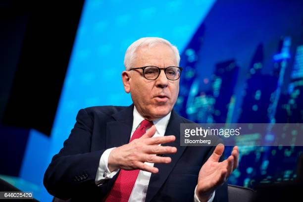 David Rubenstein cochief executive officer of the Carlyle Group LP speaks as James Gorman chief executive officer of Morgan Stanley not pictured...