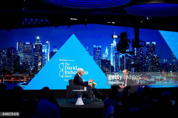 David Rubenstein cochief executive officer of the Carlyle Group LP left speaks as James Gorman chief executive officer of Morgan Stanley listens...