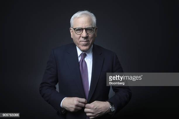 David Rubenstein, co-chief executive officer of the Carlyle Group LP, poses for a photograph following a Bloomberg Television interview on day two of...