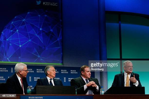 David Rubenstein cofounder and cochief executive officer of the Carlyle Group LP from left Tony Blair former UK prime minister Scott Minerd chief...