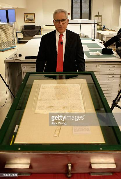 David Rubenstein, Co-founder and Managing Director of the Carlyle Group, poses for photographers during a press viewing of a 1297 version of Magna...
