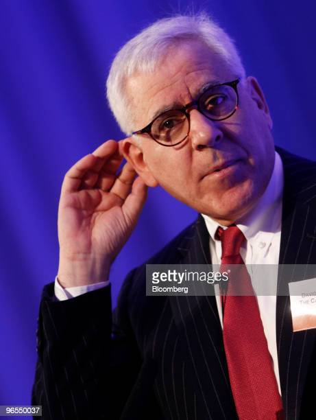 David Rubenstein founder and managing director of the Carlyle Group gestures while speaking at the Super Return International 2010 conference in...