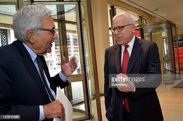 David Rubenstein managing director and cofounder of the Carlyle Group LP right speaks with Reynold Levy president of Lincoln Center for the...