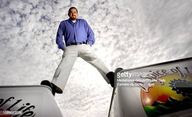 David Rubin owner and general manager of A Spice of Life Event Center and Catering Services of Boulder stands atop two of the catering vans in the...