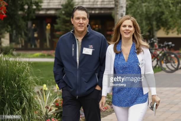 David Rubulotta, a managing director at Citigroup Inc., and Erin Burnett, a CNN anchor, arrive for the morning session of the Allen & Co. Media and...