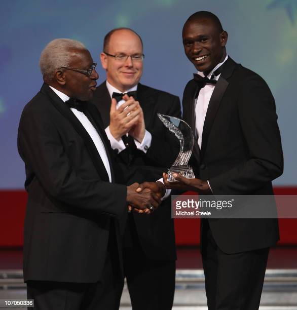 David Rudisha of Kenya receives the male athlete of the year award from Iaaf President Lamine Diack and Prince Albert II of Monaco during the IAAF...