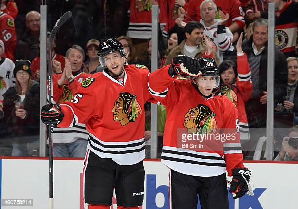 David Rundblad and Patrick Kane of the Chicago Blackhawks react after Rundblad scored his first goal as a Blackhawk against the Toronto Maple Leafs...