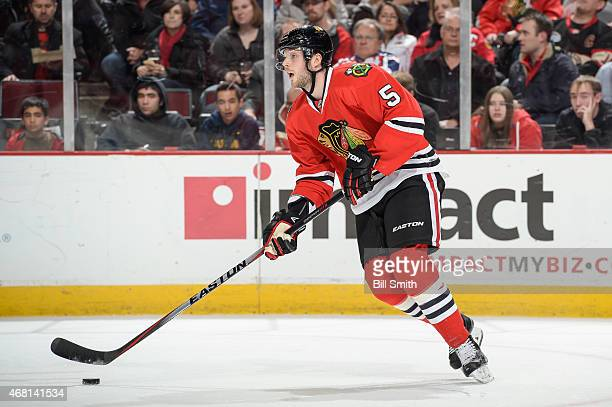 David Rundblad of the Chicago Blackhawks controls the puck during the NHL game against the Columbus Blue Jackets at the United Center on March 27...