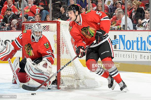David Rundblad of the Chicago Blackhawks handles the puck past goalie Corey Crawford during the NHL game against the Washington Capitals on November...