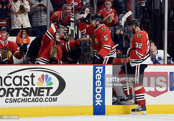 David Rundblad of the Chicago Blackhawks is congratulated after scoring a goal during the first period against the Toronto Maple Leafsat the United...