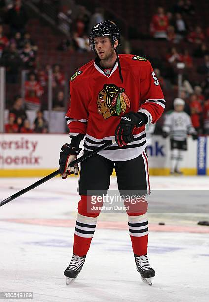 David Rundblad of the Chicago Blackhawks participates in warmups before a game against the Dallas Stars at the United Center on March 25 2014 in...