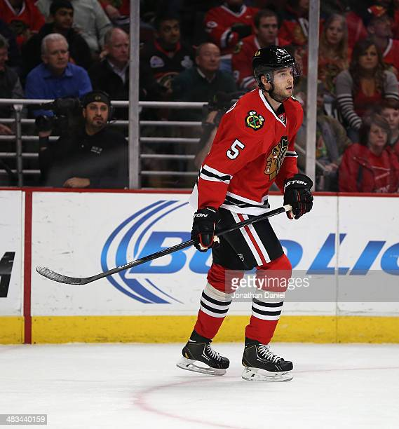 David Rundblad of the Chicago Blackhawks skates against the Dallas Stars at the United Center on March 25 2014 in Chicago Illinois The Blackhawks...