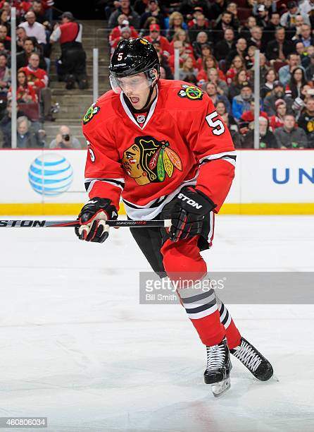David Rundblad of the Chicago Blackhawks skates during the NHL game against the Minnesota Wild at the United Center on December 16 2014 in Chicago...