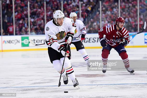 David Rundblad of the Chicago Blackhawks skates the puck into the zome during first period of the 2015 Bridgestone NHL Winter Classic against the...