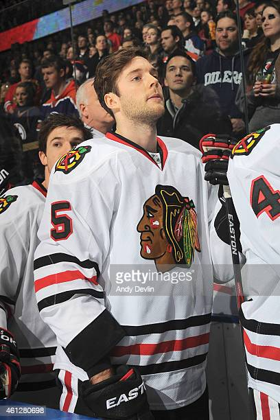 David Rundblad of the Chicago Blackhawks stands for the singing of the national anthem prior to the game against the Edmonton Oilers on January 9...