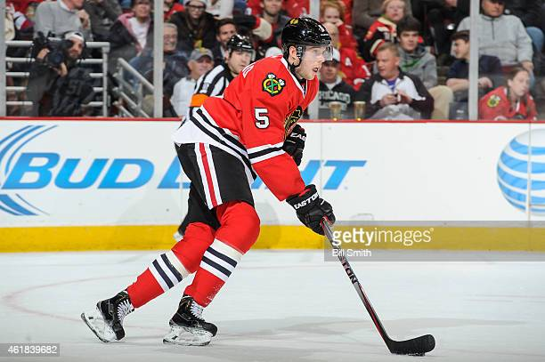 David Rundblad of the Chicago Blackhawks takes the puck up the ice during the NHL game against the Colorado Avalanche at the United Center on January...