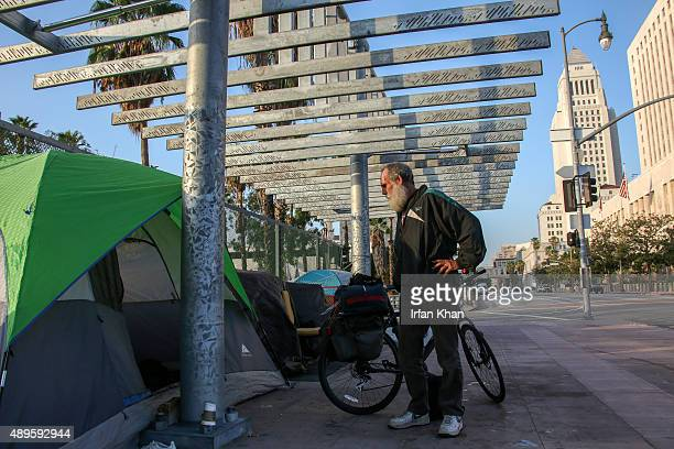 SEPTEMBER 22 2015 David Ruther who is living on the streets for last five years gets ready to rollup the tent he pitched to spend night on Main...