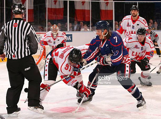 David Rutherford of Canada and Michael Forney of the USA face off during the International Ice Hockey Invitational match between Canada and the USA...