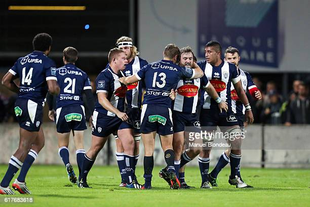 David Ryan of Agen is congratulated by his teammates after scoring a try during the Pro D2 match between Agen and Soyaux Angouleme on October 21 2016...