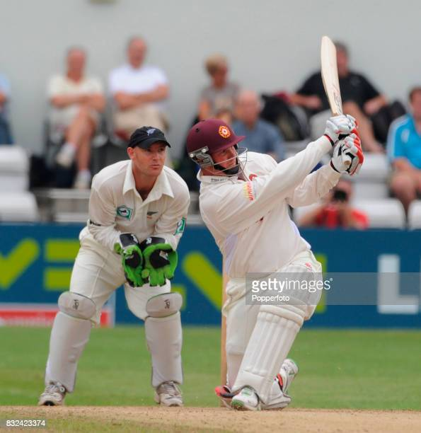 David Sales of Northampton cracks a four off the bowling of Jeetan Patel of New Zealand watched by wicketkeeper Gareth Hopkins of New Zealand during...