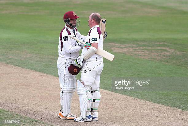 David Sales of Northamptonshire celebrates with team mate Andrew Hall after scoring a double century during the LV County Championship Division Two...