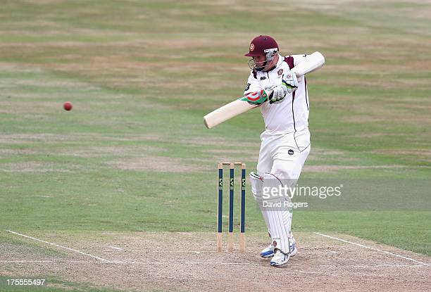 David Sales of Northamptonshire hits a four to bring up his double century during the LV County Championship Division Two match between...
