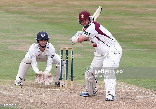 David Sales of Northamptonshire hits a full toss for four runs during the LV County Championship Division Two match between Northamptonshire and...