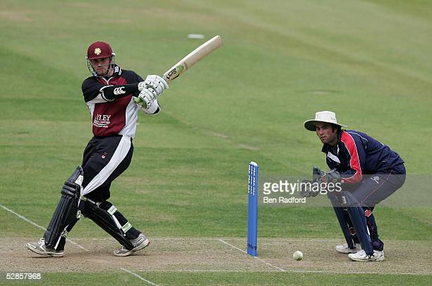 David Sales of Northamptonshire hits out watched by Ben Scott of Middlesex during the Cheltenham Gloucester Trophy match between Middlesex and...