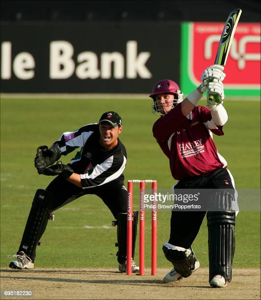 David Sales of Northamptonshire hits out watched by James Pipe of Worcestershire during the Twenty20 cricket match between Worcestershire and...