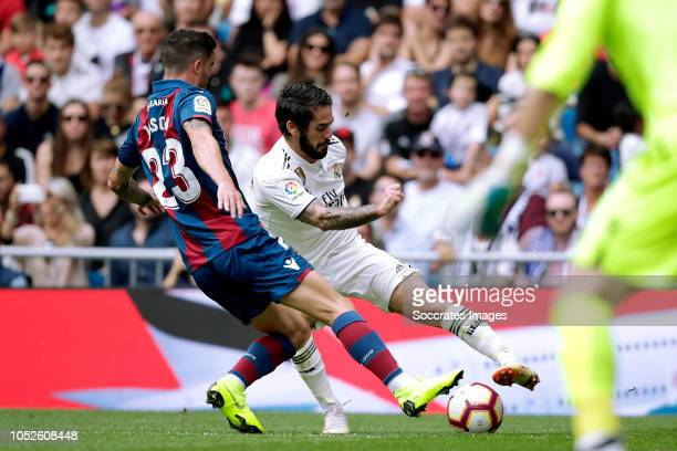 David Salgueiro of Levante UD Isco of Real Madrid during the La Liga Santander match between Real Madrid v Levante at the Santiago Bernabeu on...