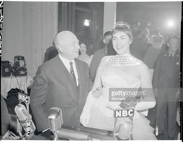 David Sarnoff RCA chairman and chairman of the National Security Training Commission is shown with Washington cherry blossom Queen Barbara Lyman who...