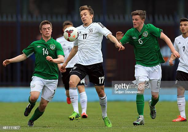 David Sauerland is in action against Adam Mc Donnell and Anthony Dolan of Ireland during the UEFA Under17 Elite Round between Germany and Ireland at...