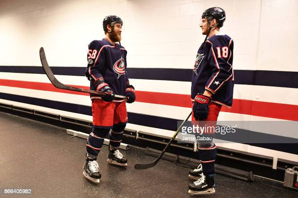 David Savard and PierreLuc Dubois of the Columbus Blue Jackets talk outside the locker room prior to a game against the Buffalo Sabres on October 25...