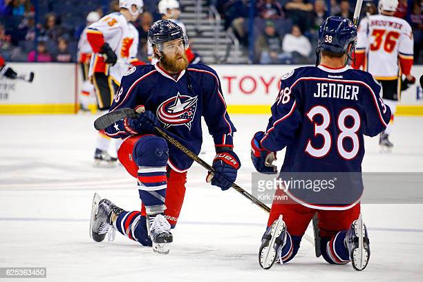 David Savard of the Columbus Blue Jackets and Boone Jenner of the Columbus Blue Jackets stretch during pregame warmups prior to the start of the game...