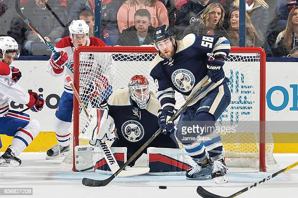 David Savard of the Columbus Blue Jackets and goaltender Sergei Bobrovsky of the Columbus Blue Jackets defend the net against the Montreal Canadiens...