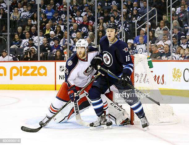 David Savard of the Columbus Blue Jackets and Shawn Matthias of the Winnipeg Jets keep an eye on the play during third period action at the MTS...