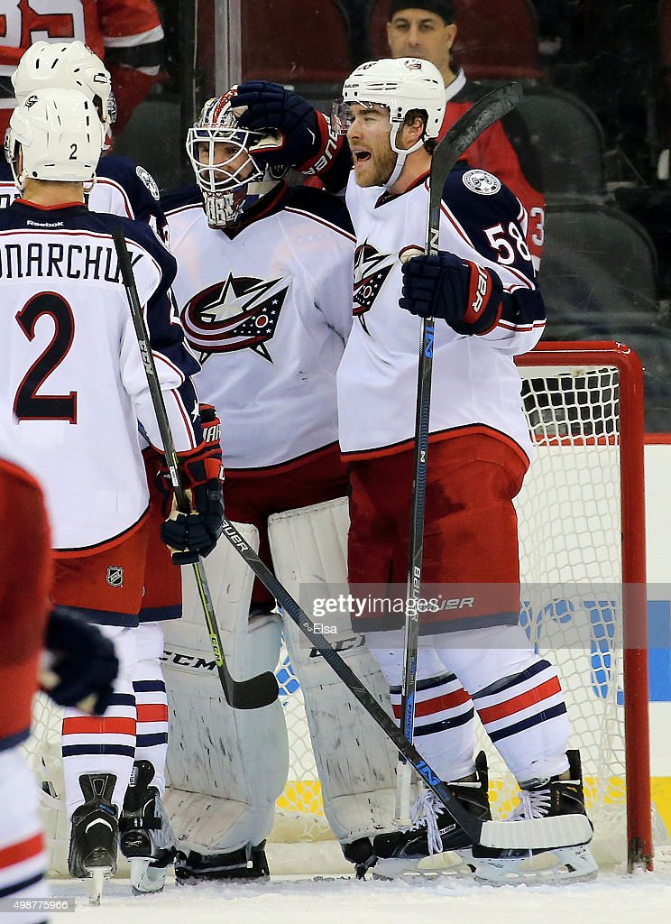 David Savard #58 of the Columbus Blue Jackets celebrates the win with teammate Sergei Bobrovsky #72 after the game against the New Jersey Devils on November 25, 2015 at the Prudential Center in Newark, New Jersey.The Columbus Blue Jackets defeated the New Jersey Devils 2-1.