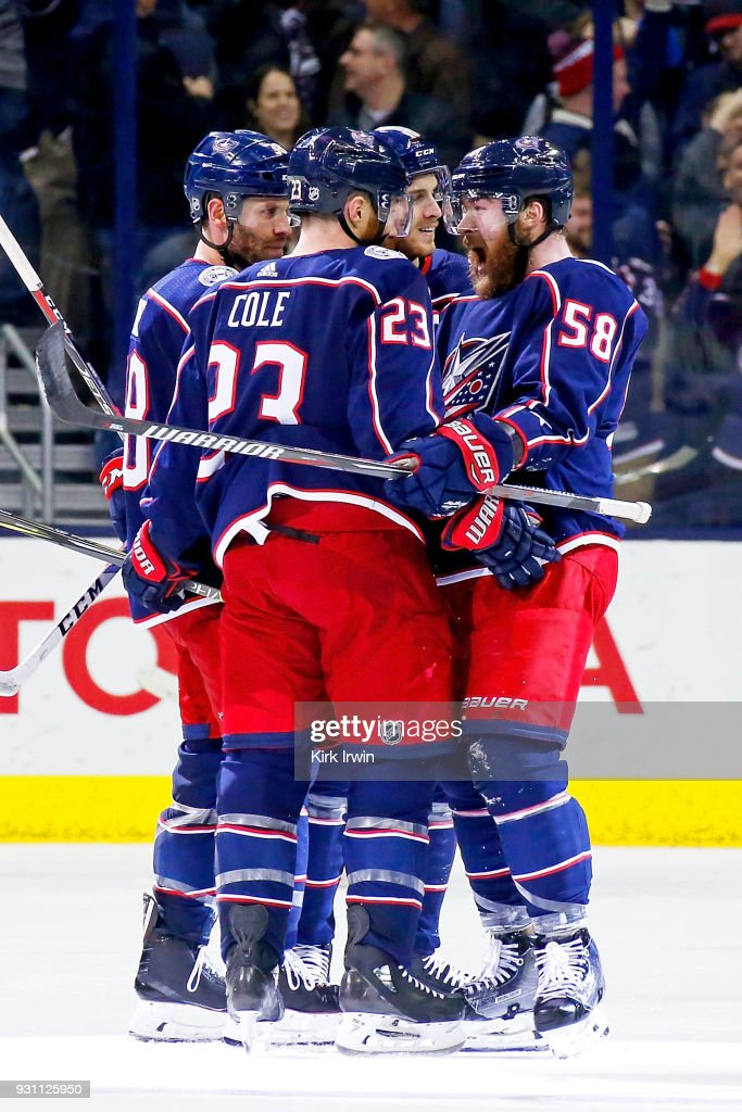 David Savard #58 of the Columbus Blue Jackets congratulates Ian Cole #23 of the Columbus Blue Jackets after scoring a goal during the third period of the game against the Montreal Canadiens on March 12, 2018 at Nationwide Arena in Columbus, Ohio. Columbus defeated Montreal 5-2.