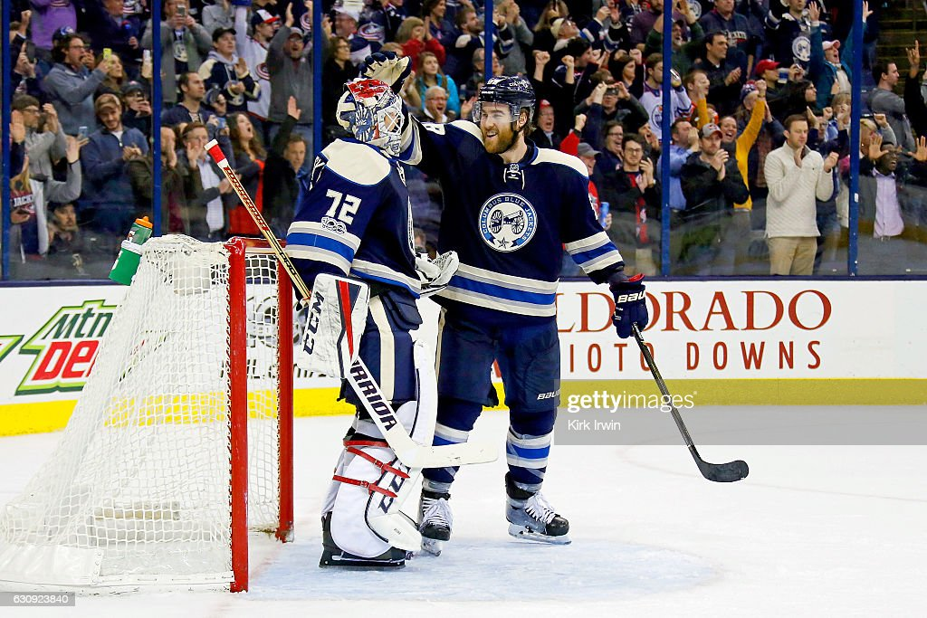 David Savard #58 of the Columbus Blue Jackets congratulates Sergei Bobrovsky #72 of the Columbus Blue Jackets after defeating the Edmonton Oilers 3-1 and extended the teams winning streak to 16 games on January 3, 2017 at Nationwide Arena in Columbus, Ohio.