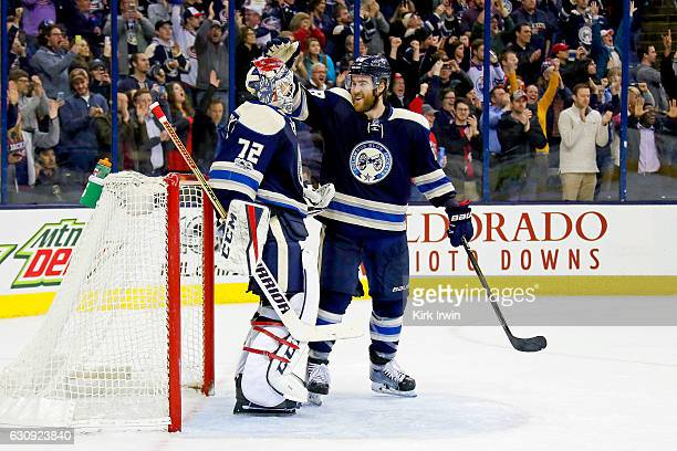 David Savard of the Columbus Blue Jackets congratulates Sergei Bobrovsky of the Columbus Blue Jackets after defeating the Edmonton Oilers 31 and...