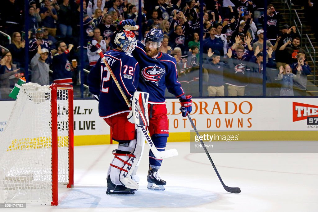David Savard #58 of the Columbus Blue Jackets congratulates Sergei Bobrovsky #72 of the Columbus Blue Jackets after defeating the New York Islanders 5-0 on October 6, 2017 at Nationwide Arena in Columbus, Ohio.
