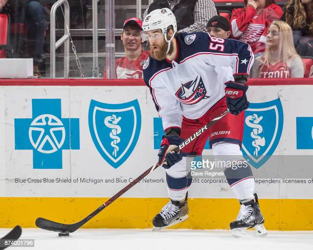 David Savard of the Columbus Blue Jackets controls the puck against the Detroit Red Wings during an NHL game at Little Caesars Arena on November 11...