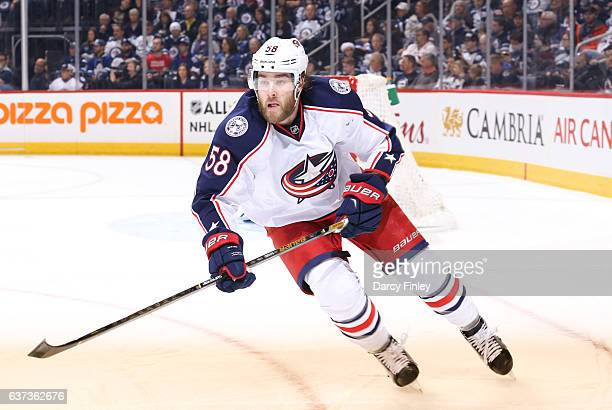 David Savard of the Columbus Blue Jackets follows the play up the ice during first period action against the Winnipeg Jets at the MTS Centre on...