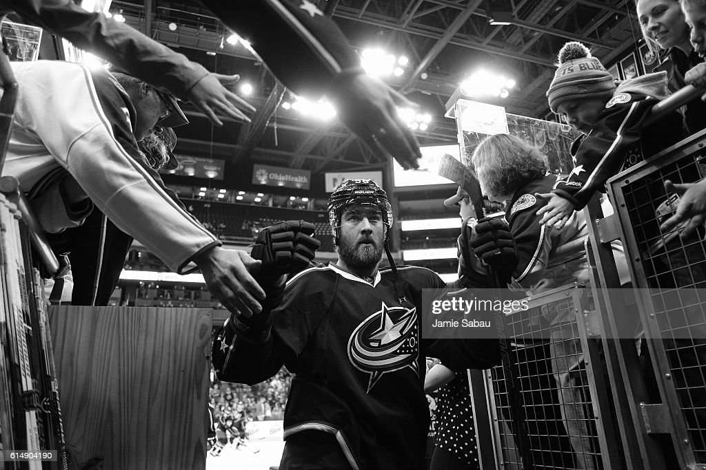 David Savard #58 of the Columbus Blue Jackets high-fives fans after pregame warmups prior to a game against the San Jose Sharks on October 15, 2016 at Nationwide Arena in Columbus, Ohio.
