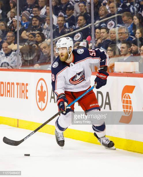 David Savard of the Columbus Blue Jackets plays the puck along the boards during first period action against the Winnipeg Jets at the Bell MTS Place...