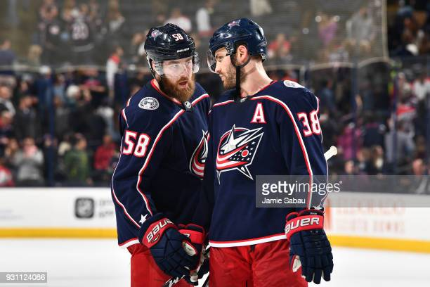 David Savard of the Columbus Blue Jackets talks with teammate Boone Jenner of the Columbus Blue Jackets prior to a faceoff during the third period of...