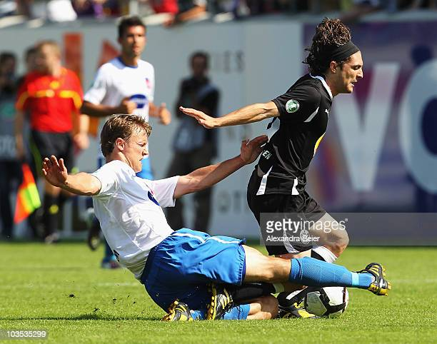 David Schittenhelm of Heidenheim fights for the ball with David Ulm of Sandhausen during a Third League match between 1.FC Heidenheim and SV...