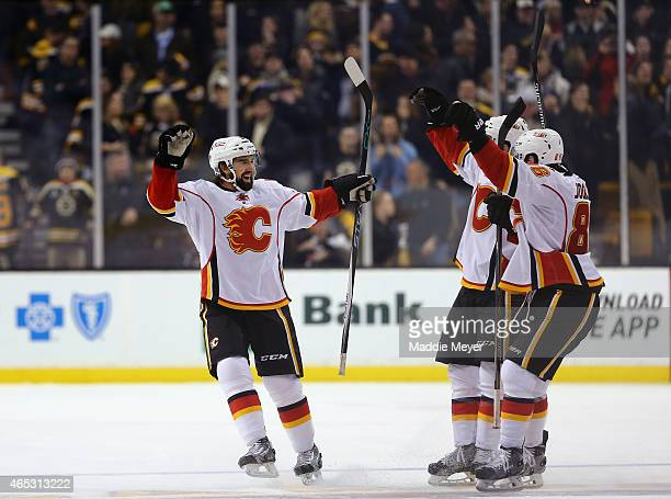 David Schlemko of the Calgary Flames is congratulated by teammates after scoring the game winning goal during a shootout against the Boston Bruins at...