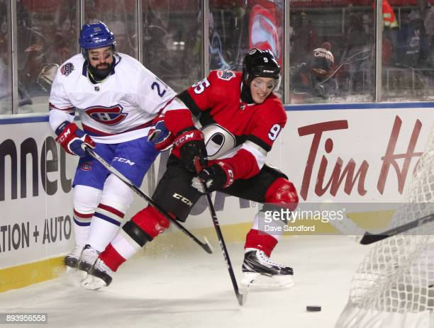 David Schlemko of the Montreal Canadiens battles for a loose puck with Matt Duchene of the Ottawa Senators during the 2017 Scotiabank NHL100 Classic...