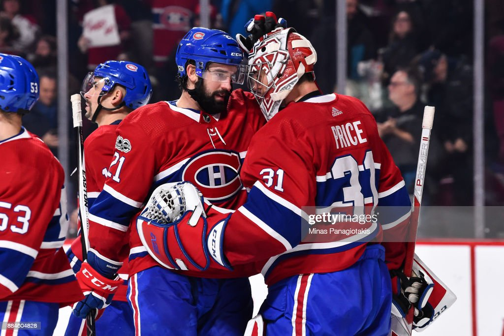 David Schlemko #21 of the Montreal Canadiens congratulates goaltender Carey Price #31 for their victory against the Detroit Red Wings during the NHL game at the Bell Centre on December 2, 2017 in Montreal, Quebec, Canada. The Montreal Canadiens defeated the Detroit Red Wings 10-1.